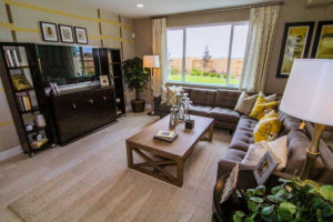Family room of home in Wichita Falls with coffee table and large window